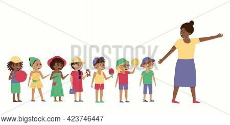 The Teacher Takes The Children For A Walk. Boys And Girls Walk And Play With Their Favorite Toys. In