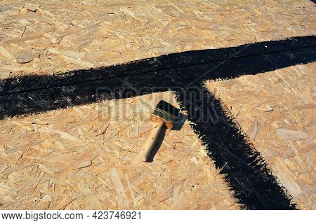 A Close-up On An Osb Boards, Plywood Roof Sheathing, Roof Deck With Gaps Sealed With Bitumen, Tar Be