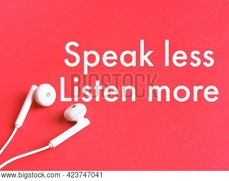 Phrase Speak Less Listen More Written On Red Background With Earphone.