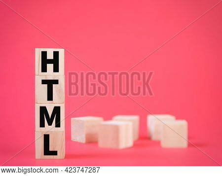 Word Html Or Hypertext Markup Language On Wooden Cubes With Blurry Background.