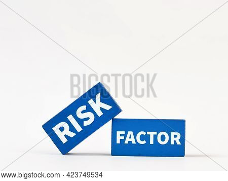Blue Wooden Blocks Written Risk Factor Isolated On White Background. Business And Economy Concept.