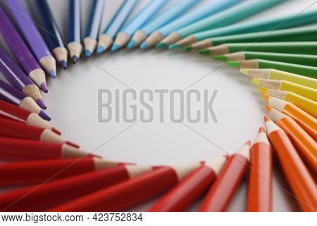 Many Sharp Multicolored Sharp Pencils Lying In Shape Of Circle Closeup Background