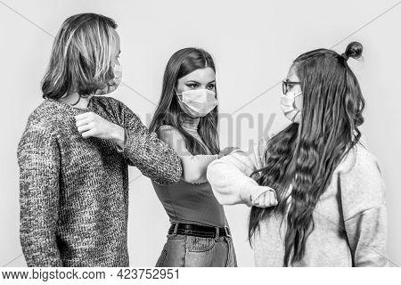 Elbows Bump. People Friends Bump Their Elbows, Coronavirus, Social Distance And Friendship Concept.