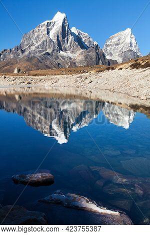 Mount Tabuche Peak Mirroring In Small Mountain Lake, Nepal Himalayas Mountains, Trek To Everest Base
