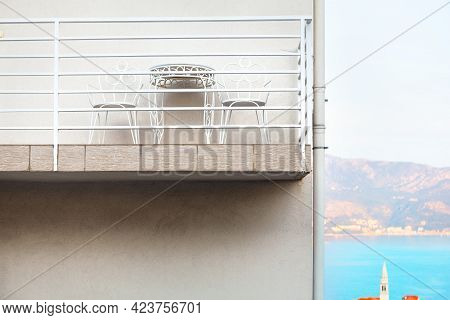 Balcony With Chairs And Table . Coastal Tourist Resort With Comfortable Balcony . Summer Vacation Co