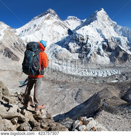 View Of Mount Everest, Lhotse And Nuptse From Pumo Ri Base Camp With Tourist On The Way To Base Camp