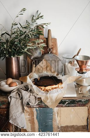 Homemade San Sebastian Burnt Cheesecake On Kitchen Counter