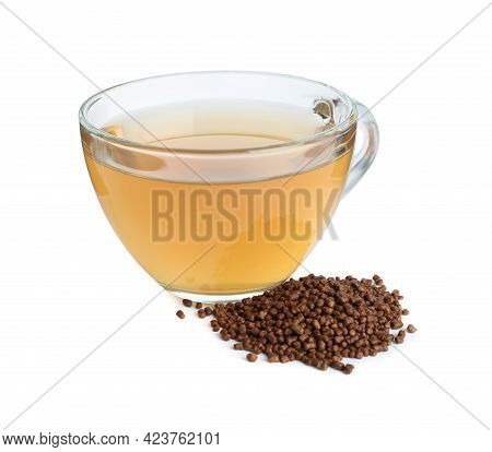 Glass Cup Of Buckwheat Tea And Granules On White Background