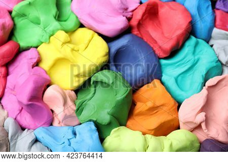 Pile Of Colorful Plasticine As Background, Top View