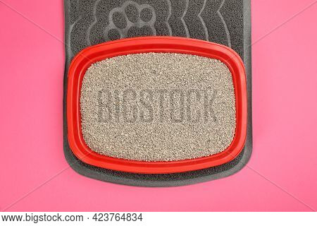 Rubber Mat And Cat Litter Tray With Filler On Pink Background, Top View
