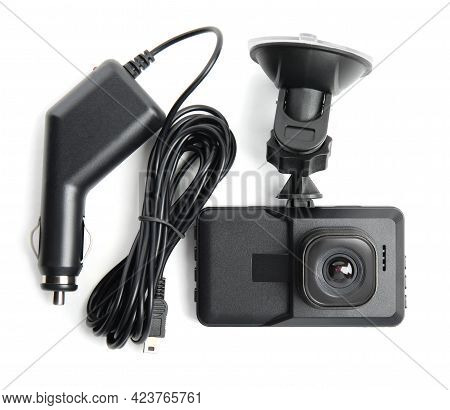 Modern Car Dashboard Camera With Suction Mount And Charger On White Background, Top View