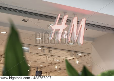 H M Logo Of The Clothing And Textile Brand In The Shopping Center. Glass Shop Window Krasnoyarsk, Ru
