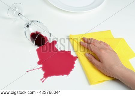 Woman Cleaning Spilled Wine On White Background, Closeup