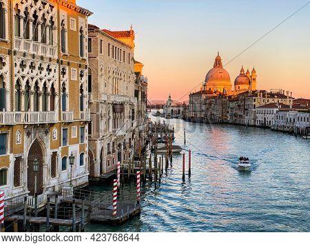 View of the Grand Canal and Basilica Santa Maria della Salute from the Ponte dell'Accademia in Venice, Italy