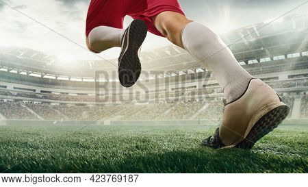 Cropped Male Soccer, Football Player In Action, Motion With Ball At The Stadium During Sport Match O