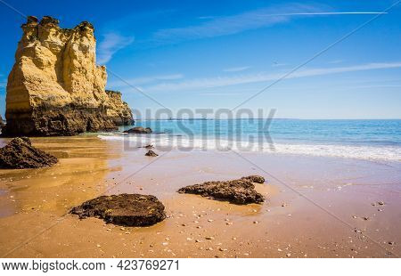 Praia Da Dona Ana Beach, Sandy Beach With Clear Blue Water Between Cliffs On A Sunny Day, No People,