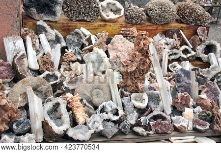 Traditional moroccan souvenirs - fossilized shells of ammonites, quartz crystals, minerals, Petrified fossil stromatolite, street market (souk) in Essaouira, Morocco, North Africa