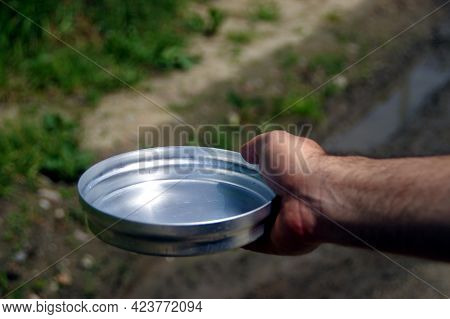 Empty Bowl In Hand As Concept Of Global Famine And Hunger Crisis