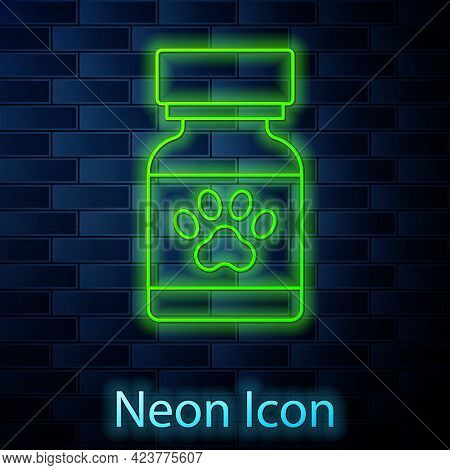 Glowing Neon Line Medicine Bottle And Pills Icon Isolated On Brick Wall Background. Container With P