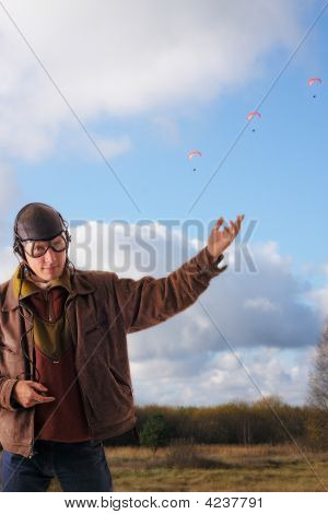 Pilot Shows On Three Parachute In The Sky