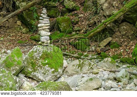 Single Rock Stack In A Streambed. Pile Of Stacked Rocks Balancing On A Big Rock In A Bed Of A Wild S
