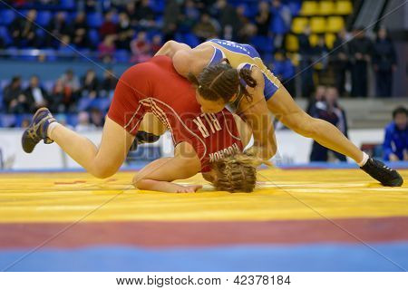 KIEV, UKRAINE - FEBRUARY 16: Match between Huchok, Belarus, red and Fomenko, Russia during XIX International freestyle wrestling and female wrestling tournament in Kiev, Ukraine on February 16, 2013