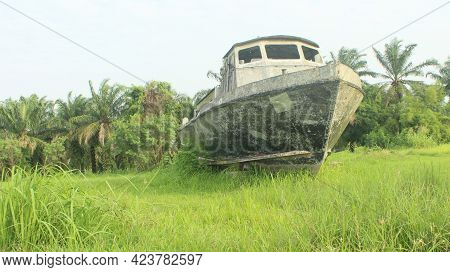 Abandoned Rust Ferry Shipwreck On The Field
