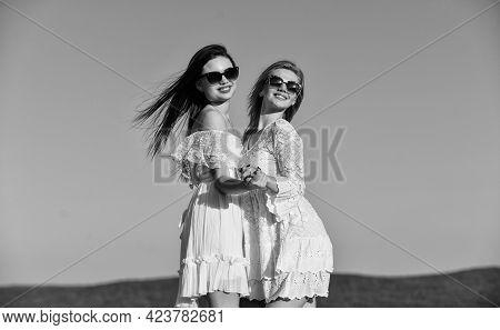 Harmony And Balance. Psychology Concept. Beautiful Women On Sunny Day Blue Sky Background. Sisterhoo