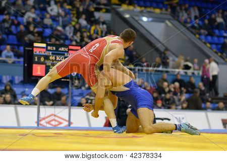 KIEV, UKRAINE - FEBRUARY 16: Match between Chakayev, Russia, red, and Safarian, Armenia during International freestyle wrestling and female wrestling tournament in Kiev, Ukraine on February 16, 2013