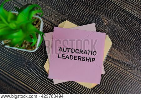 Autocratic Leadership Write On Sticky Notes Isolated On Wooden Table.