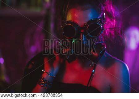 Portrait Of A Cyberpunk Girl In A Gas Mask And Glasses In The Style Of The Post-apocalypse. Steampun