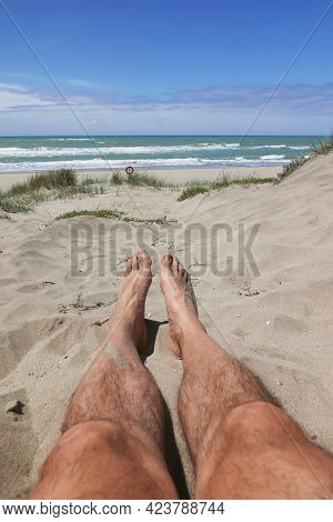 Male Nude Tanned Legs At Capocotta Beach, Italy