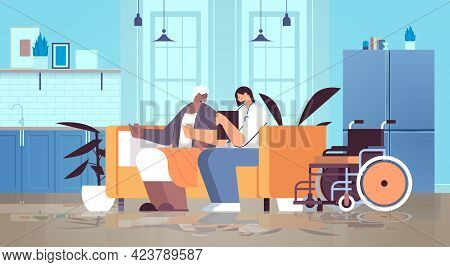 Friendly Nurse Or Volunteer Supporting Elderly Woman Home Care Services Healthcare And Social Suppor