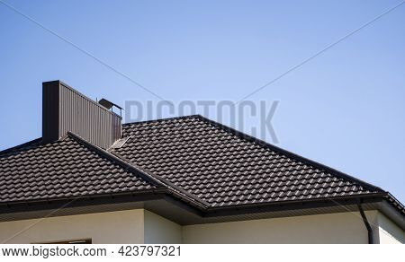 Brown Corrugated Metal Profile Roof Installed On A Modern House. The Roof Of Corrugated Sheet. Roofi