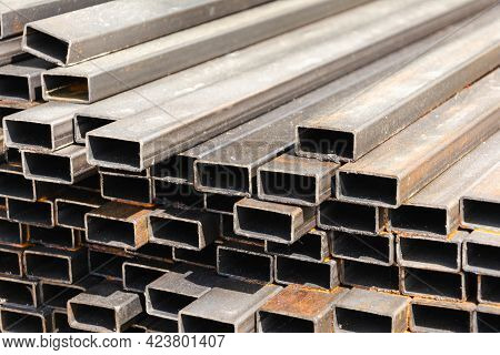 Metal Rectangular Profile In A Stack, Metal Pipes Of Rectangular Cross-section On The Site Of A Buil