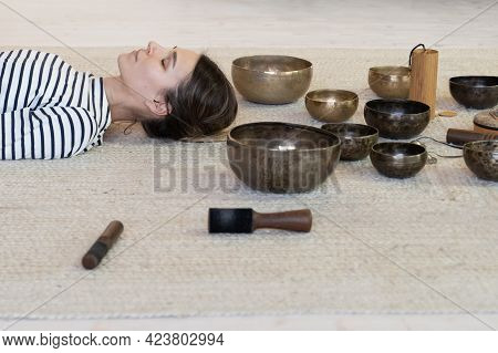Meditation With Tibetan Singing Bowls Therapy: Relaxed Female Meditating From Tibet Sound Massage. O