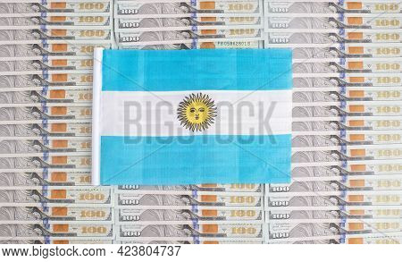 Argentina Flag On A Background From Dollar Banknotes. Concept Of The Relationship Of The Argentina M
