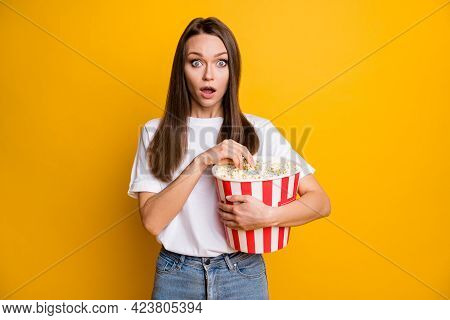 Photo Portrait Of Amazed Girl Keeping Carton Box With Pop Corn Watching Blockbuster Isolated Bright