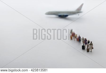 Miniature People, Vacation Travellers In Queue Ready To Board Aeroplane Flight