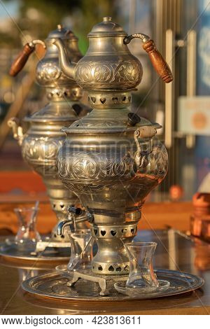 Traditional turkish samovar tea pot at the table in outdoor cafe in Turkey