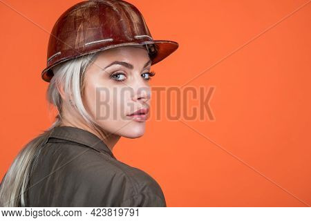 Worker Portrait. Engineer On Orange Background. Foreman Girl Wear Safety Hardhat. Labor Day.