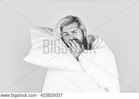 Yawning Male. Bearded Guy Wear White Blanket Sleeping At Hotel Bedroom. Bed Rest While Sick. Man In