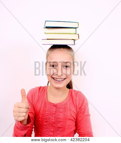 Fanny Girl With Ok Sign And Books On Head
