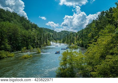 Several Groups Of People In Large Rafts Going Whitewater Rafting Down The Ocoee River In Tennessee A