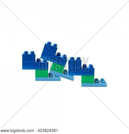 Blue and green plastic building blocks on white
