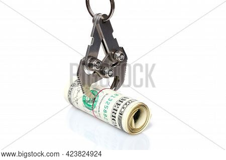 Metal Hook Grabs Roll Of American Dollars. Concept Of Capture And Retention Of Revenues By Stock Exc