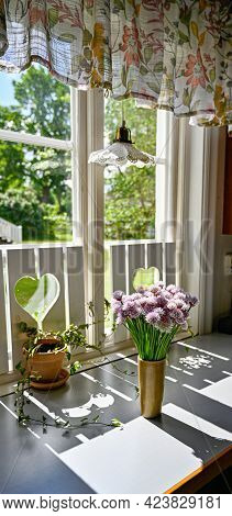 A Vase Full Of Chive In Ful Bloom