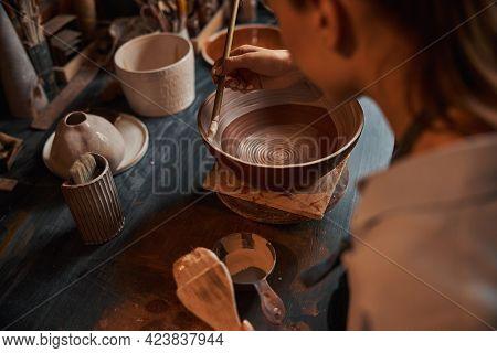 Beautiful Elegant Female Artisan During Painting Process Of Ceramic Tableware In Pottery Workshop