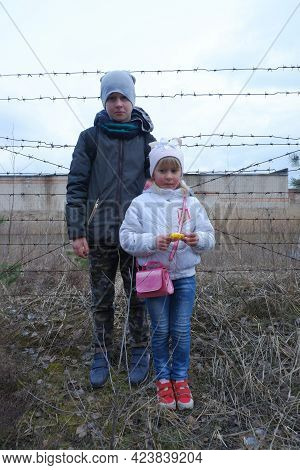 Children On The Background Of Barbed Wire. Lack Of Freedom, Hunger, Poverty ...