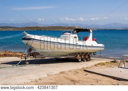 Motorboat On The Seashore. The Island Of Paros. Cyclades Islands, Greece